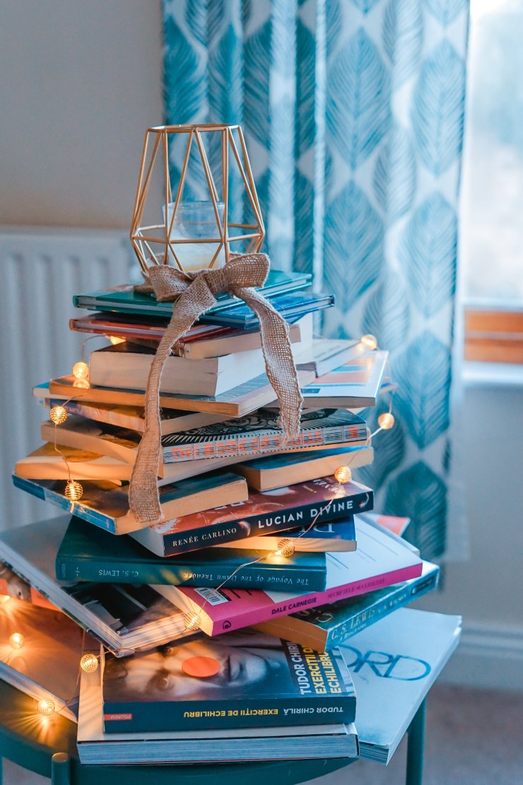 Stack of books decorated with lights