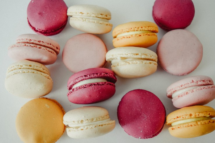 Colourful french macaroons,purple, pink, yellow, white. Yummy!