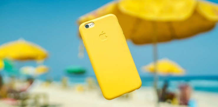 Bright yellow smartphone on the air at the beach