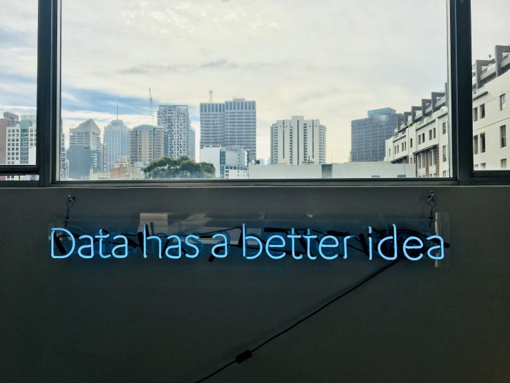 White building with DATA HAS A BETTER IDEA signage
