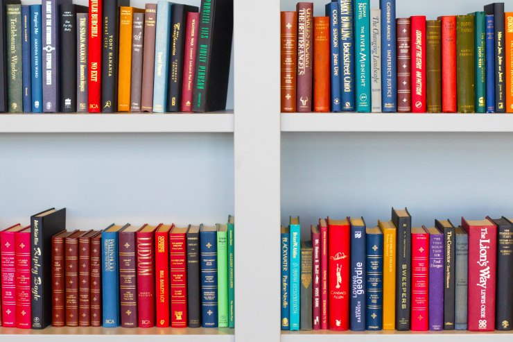 Various colourful books in bookcase