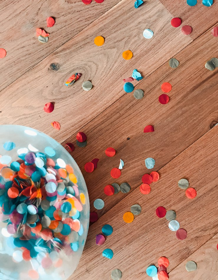 Assorted-colour of sprinkle dots on brown floor