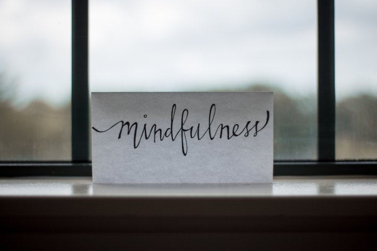 Mindfulness note on a window