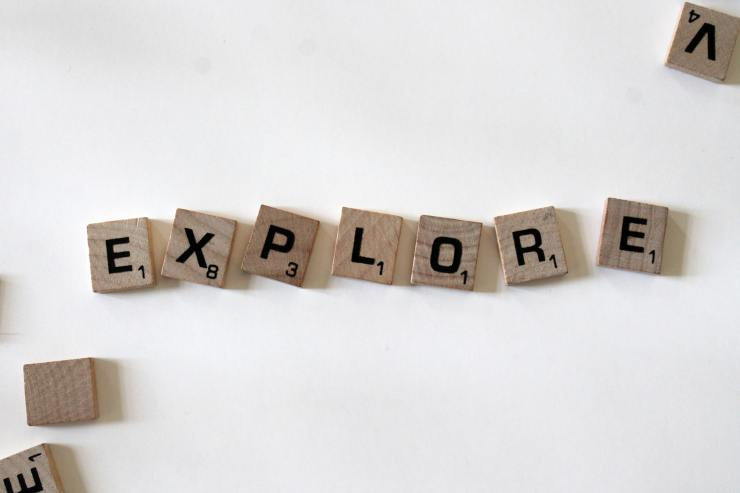 Explore, move forward, embrace your warrior spirit-Explore written using wooden blocks from Scrabble